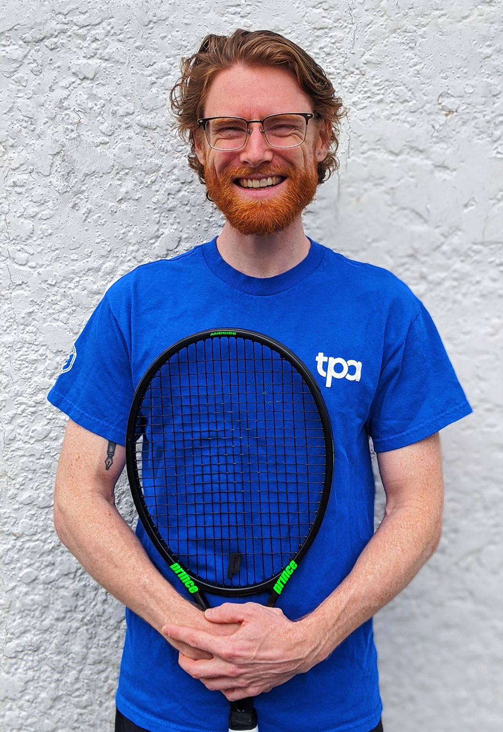 Photo of Dan, a tennis instructor in Victoria, BC, holding a tennis racquet